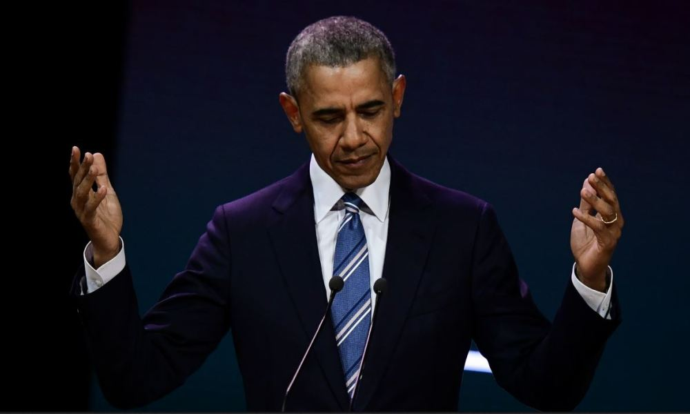 Former US President Barack Obama gestures as he speaks at an innovative communications conference organised by Les Napoleons network group, where he appears as a guest of honour, in Paris, on December 2, 2017.  Martin BUREAU / AFP