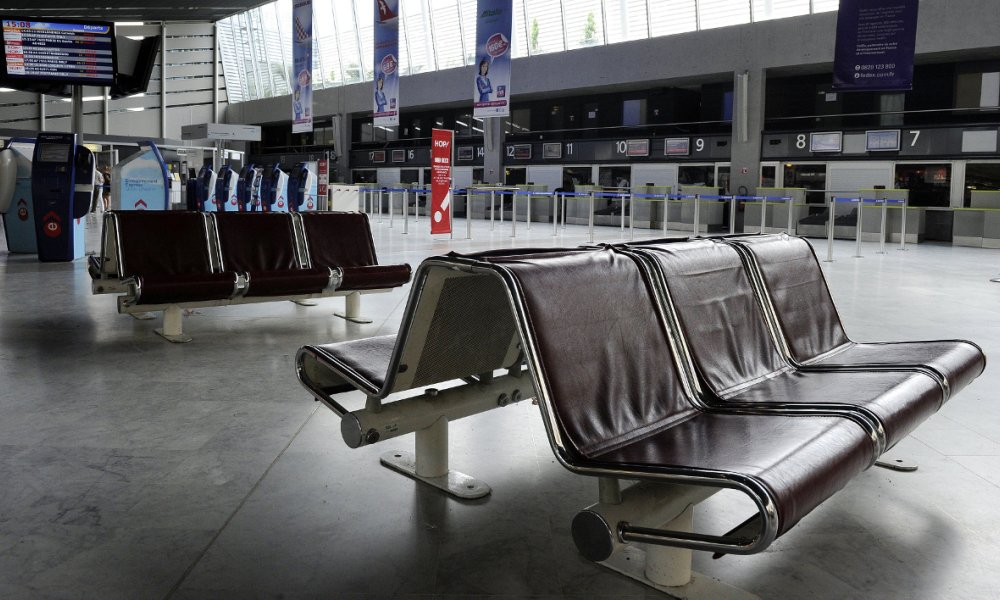 """View of the empty boarding desks taken on June 11, 2013 at Montpellier's airport, southern France, as air traffic controllers kicked off a three-day strike against EU plans to create a single European airspace, cancelling hundreds of flights in France today. Controllers across the continent are due to stage various protests such as working to rule on June 12 against what the European Transport Workers' Federation calls """"a never-ending process of liberalisation, deregulation and cost cutting."""" AFP PHOTO / PASCAL GUYOT PASCAL GUYOT / AFP"""