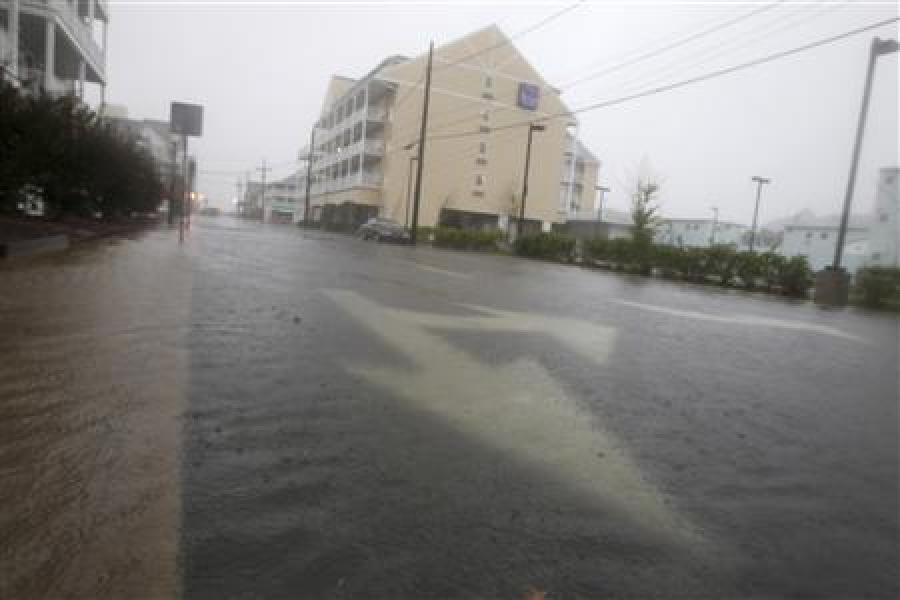 Floodwaters caused by hurricane irene cover a sidewalk on a street in ocean city