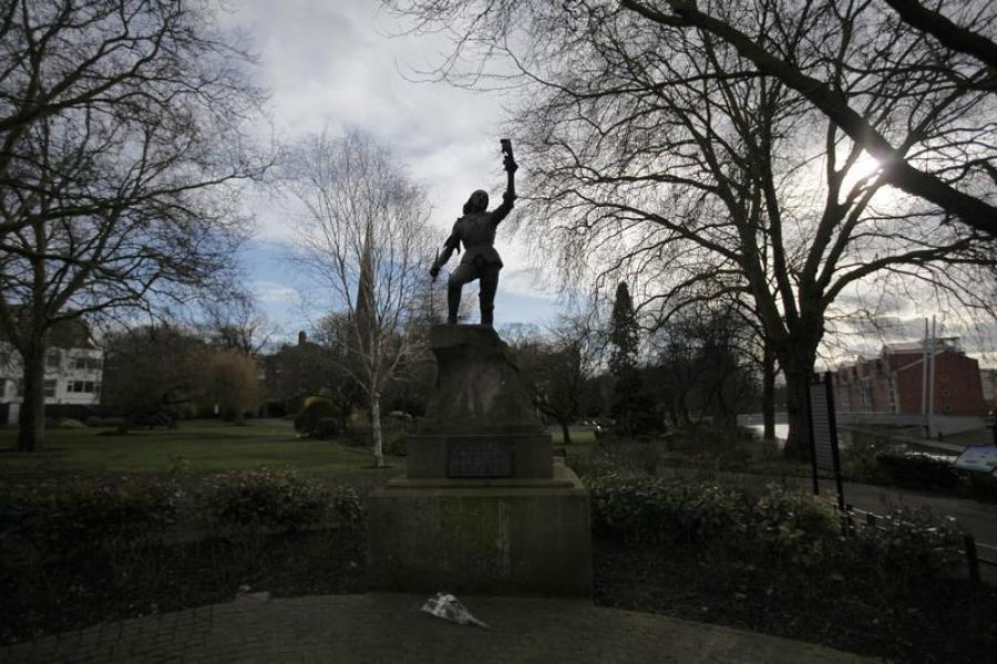 A floral tribute lies below a statue of king richard iii in leicester
