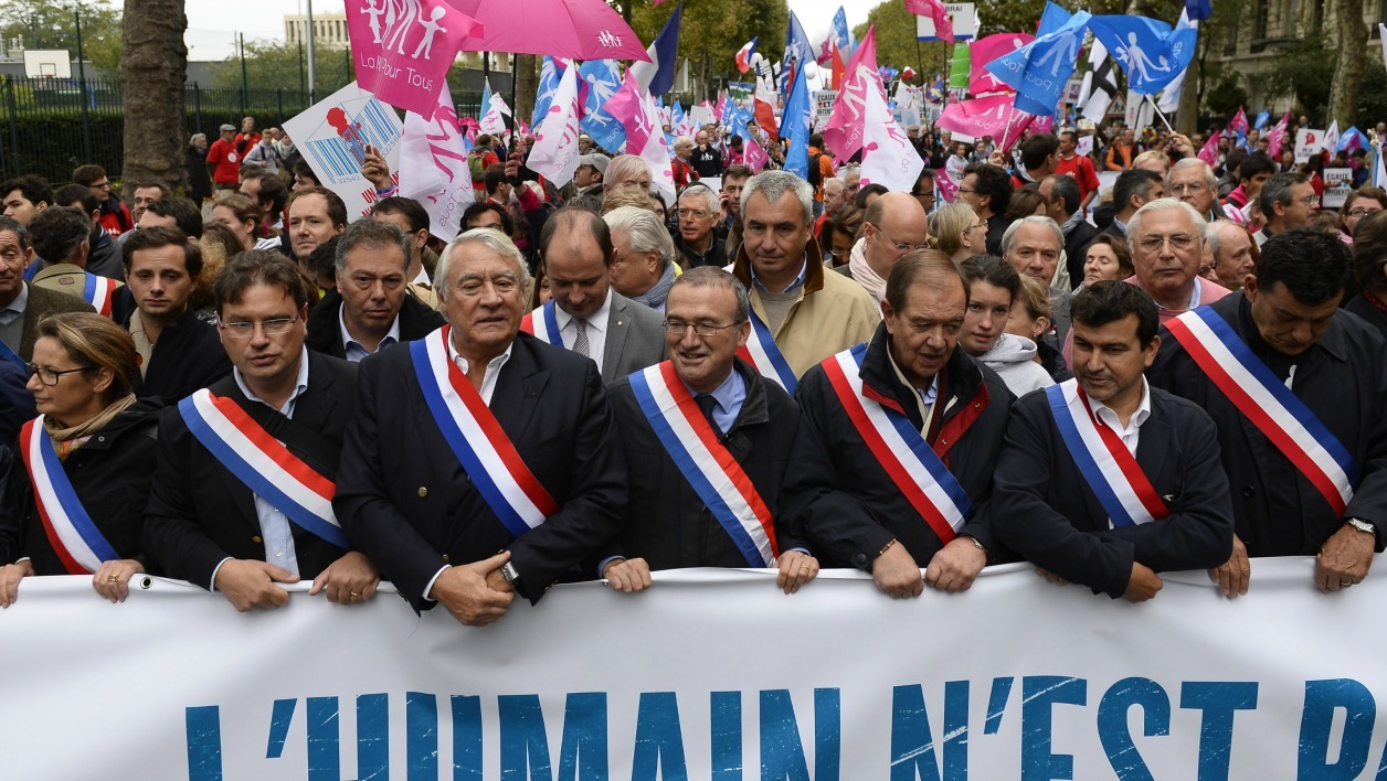 "French members of parliament Claude Goasguen (3dL), Herve Mariton (C), and Patrick Ollier (4thR) and elected representatives protest with thousands of supporters of the anti-gay marriage ""La Manif Pour Tous"" (Protest for Everyone) movement against medically assisted procreation and the use of surrogate mothers, on October 5, 2014 in Paris."