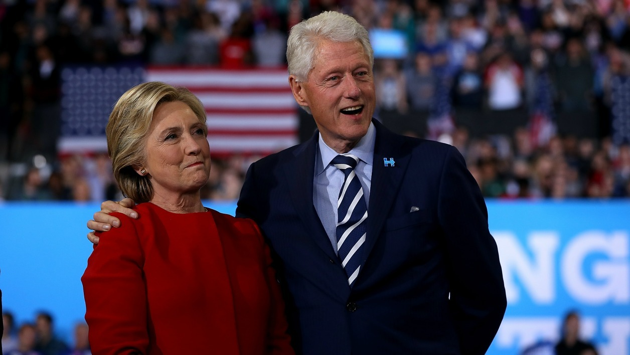 RALEIGH, NC - NOVEMBER 08: Democratic presidential nominee former Secretary of State Hillary Clinton (L) and her husband former U.S. President Bill Clinton look on during a campaign rally at North Carolina State University on November 8, 2016 in Raleigh, North Carolina.