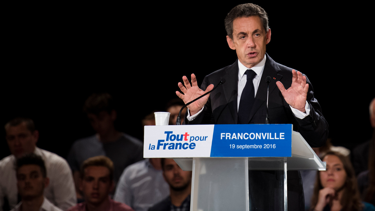 Former French president and candidate for the right-wing Les Republicains (LR) party primary ahead of the 2017 presidential election, Nicolas Sarkozy, delivers a speech as he holds a public meeting as part of his election campaign, on September 19, 2016, in Franconville, near Paris.  Martin BUREAU / AFP