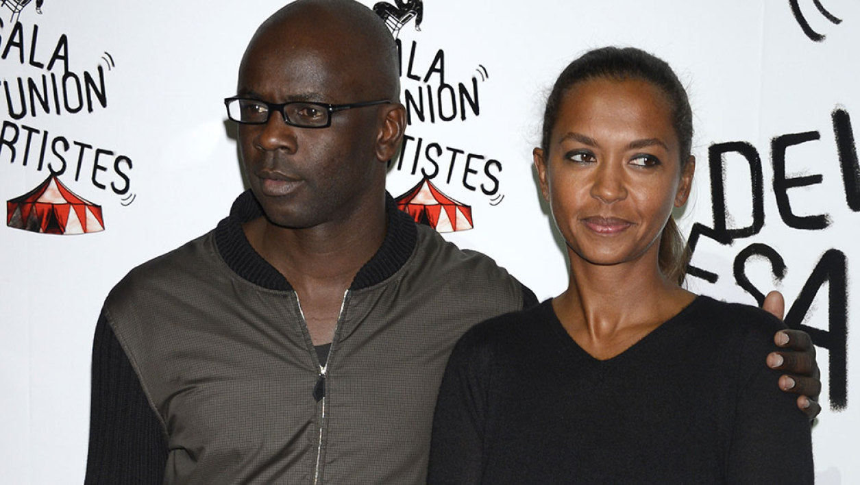 """This file photo taken on November 12, 2012 shows former French football player Lilian Thuram (L) posing with French TV host Karine Le Marchand at the 50th edition of the """"Gala de l'union des Artistes"""" at the Alexis Gruss circus in Paris on November 12, 2012. French TV presenter Karine Le Marchand is suing her former companion Lilian Thuram for defamation at a Paris court on December 18, 2015 for comments he made about their separation."""