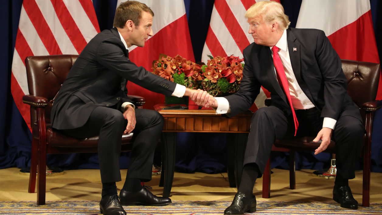 France's president Emmanuel Macron (L) and US President Donald Trump shake hands before a meeting at the Palace Hotel during the 72nd session of the United Nations General Assembly on September 18, 2017, in New York.  ludovic MARIN / AFP