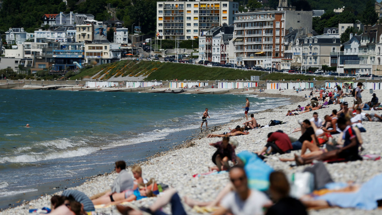 People sunbath on the beach on May 27, 2017 in Le Havre, northwestern France.  CHARLY TRIBALLEAU / AFP