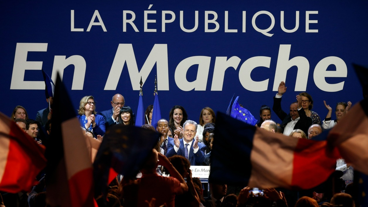 French Minister of Territorial Cohesion Richard Ferrand (C) delivers a speech during a campaign meeting for the 90 La Republique en Marche (REM) party candidates in the Ile-de-France region for the upcoming legislative elections, on May 23, 2017, in Aubervilliers, near Paris.  GEOFFROY VAN DER HASSELT / AFP
