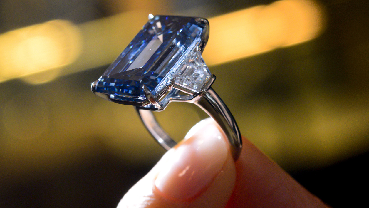This photo taken on May 12, 2016 in Geneva during a press preview by Christies's auction house shows the 'Oppenheimer Blue,' a rare fancy vivid blue diamond weighing 14.62 carat. The Blue Oppenheimer will be auctioned in Geneva on May 18 with a pre-sale estimate of $38-45 million and could become the most expensive cut diamond in the world, according to the house Christies. FABRICE COFFRINI / AFP