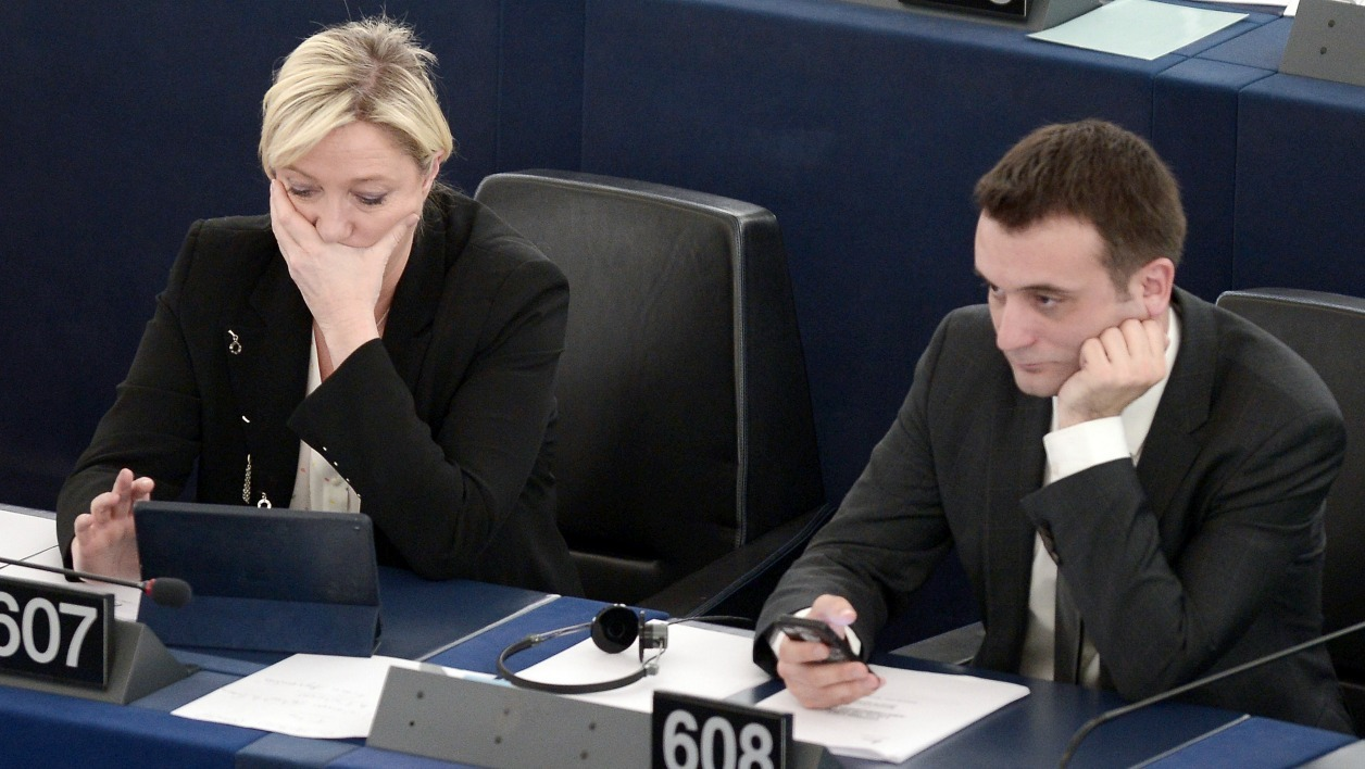 France's leader of the far-right political party Front National (FN) Marine Le Pen (L) and FN vice-president Florian Philippot take part in a voting session at the European Parliament in Strasbourg, eastern France, on April 29, 2015. AFP PHOTO / FREDERICK FLORIN  FREDERICK FLORIN / AFP