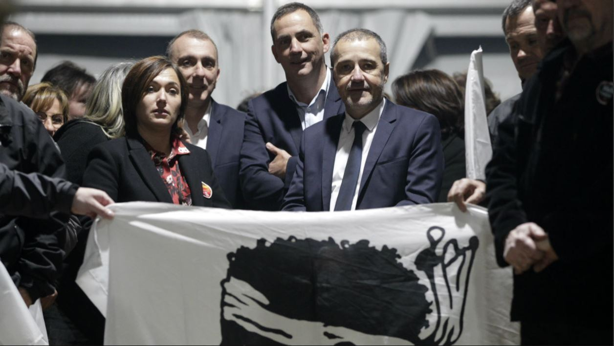 Pe a Corsica nationalist party candidates for Corsican regional elections (from 2nd R) Jean-Guy Talamoni, Gilles Simeoni, Jean-Christophe Angelini and Josepha Giacometti stand beneath a Corsican flag during a meeting in Bastia, on the French Mediterranean Island of Corsica, on November 30, 2017. Regional elections will be held on the island on December 3 and 10.