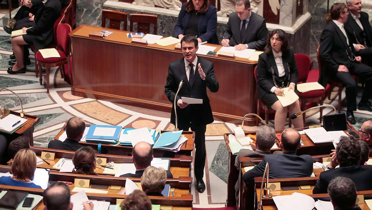 French Prime Minister Manuel Valls gestures as he speaks at the French National Assembly in Paris on February 9, 2016, as French lawmakers examined proposed changes to the constitution. France's lower house of parliament is to vote on plans to enshrine a state of emergency into the constitution, including a controversial measure to strip French nationality from those convicted of terrorism and serious crimes.