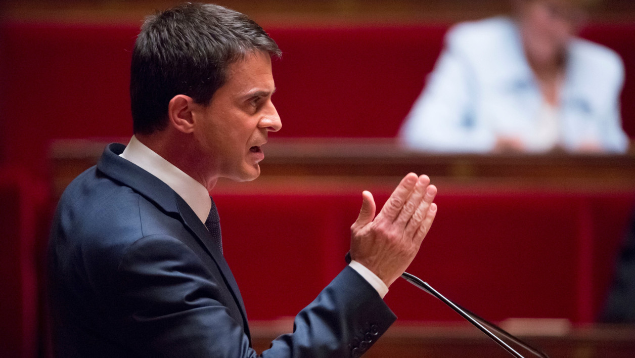 French Prime minister Manuel Valls gives a speech during a debate ahead of a no-confidence vote, on May 12, 2016 at the National Assembly in Paris. France's embattled Socialist government faces a no-confidence vote on May 12 after bypassing parliament to force through a labour reform bill that has drawn hundreds of thousands onto the streets over the last two months. The proposed labour reform, which would make it easier for employers to hire and fire workers, has sparked waves of sometimes violent protests across France since early March. Hollande's cabinet decided at an extraordinary meeting on May 10, 2016 to invoke the constitution's controversial Article 49.3.  GEOFFROY VAN DER HASSELT / AFP