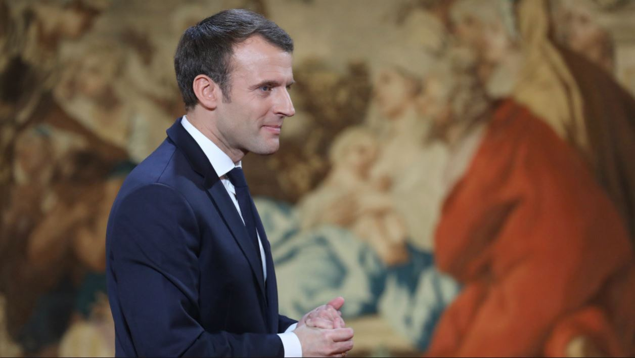 French President Emmanuel Macron leaves after delivering his New Year wishes to the press at the Elysee Palace in Paris