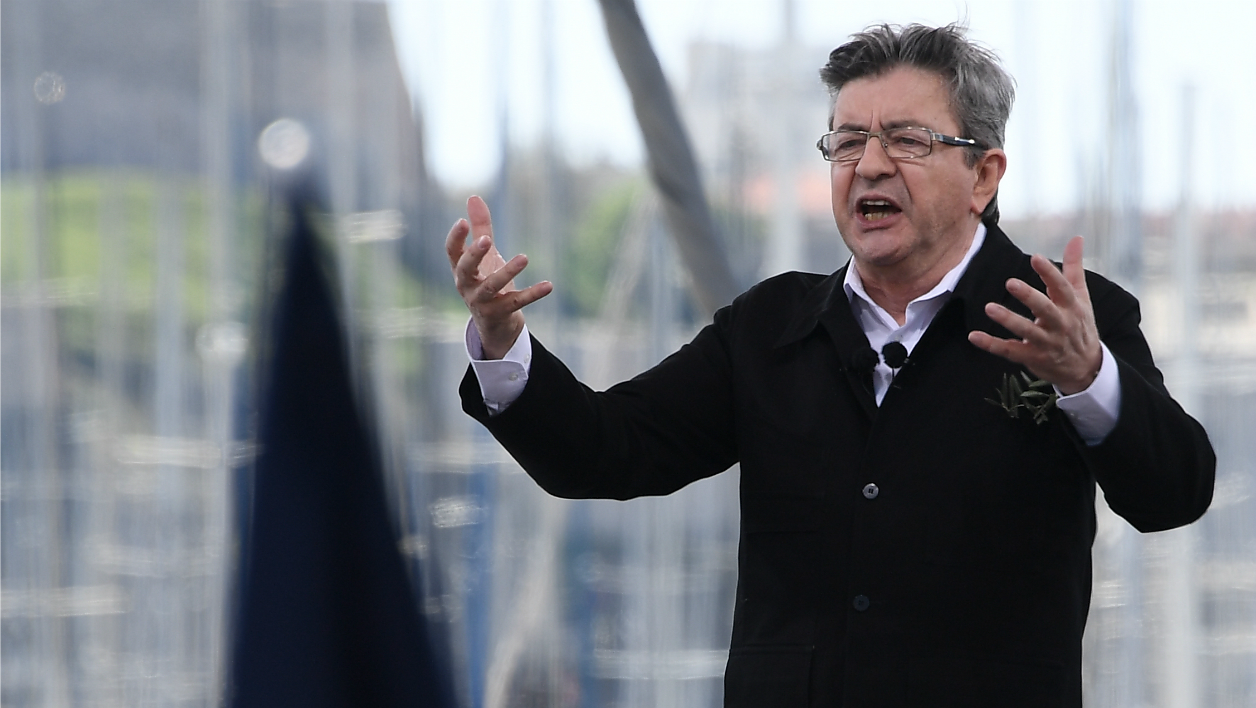 French presidential election candidate for the far-left coalition La France insoumise Jean-Luc Melenchon delivers a speech during a public meeting at the Old Port of Marseille, southern France, on April 9, 2017.  Anne-Christine POUJOULAT / AFP