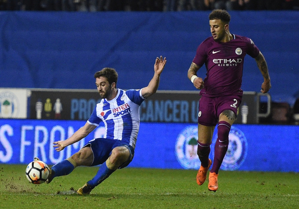 Will Grigg inscrivant le but de la victoire face à Manchester City