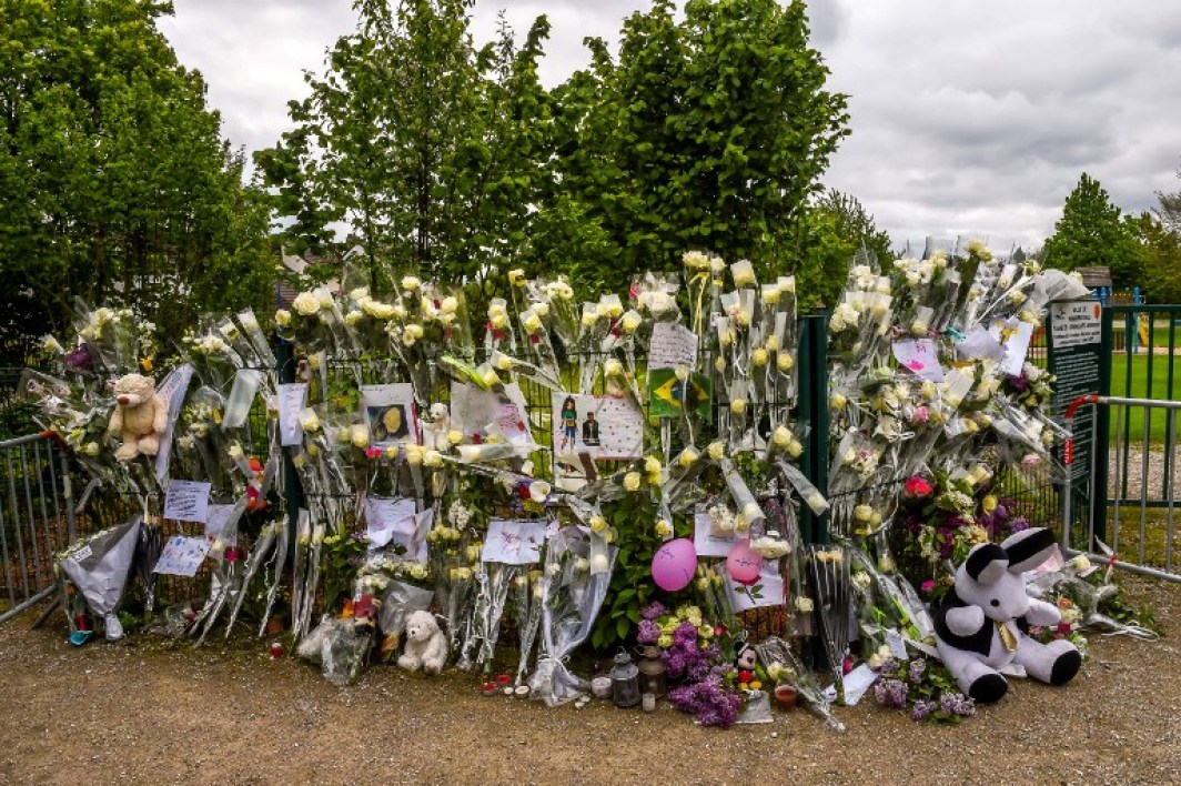 Flowers are seen at a makeshift memorial for Angelique, a 13-year-old teenager whose body was found in the night from April 28 to April 29 on April 30, 2018 in the French northern city of Wambrechies, near Lille. The body of Angelique, who had disappeared since April 25, was found in the night from April 28 to April 29 in the countryside in Quesnoy-sur-Deule, northern France, and a man was arrested, according to police on April 29.