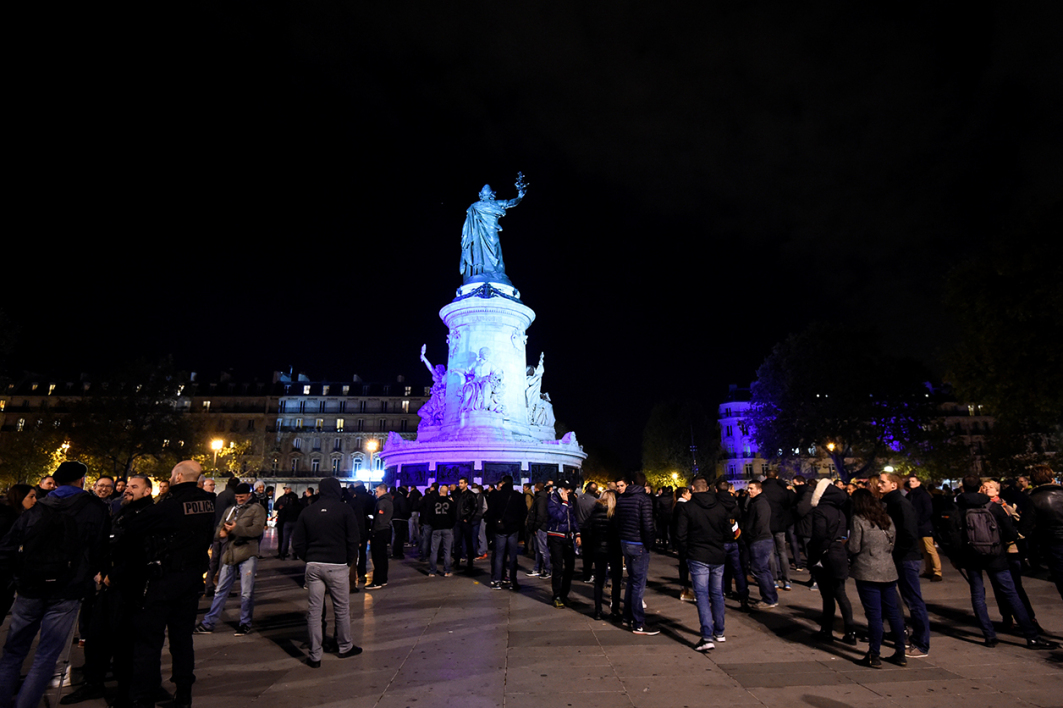 People take part in a rally of French police officers protesting over mounting attacks on officers, at Place de la Republique, in Paris, on October 19, 2016. Dozens of French police officers demonstrated Tuesday night in and around Paris and in the southern city of Marseille, the second wildcat protest in as many days over mounting attacks on officers. Around 400 off-duty officers demonstrated outside a police station in the suburb of Evry, near a town where a firebomb