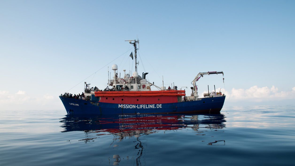 This handout picture obtained on June 22, 2018 from the German NGO 'Mission Lifeline' shows migrants onboard the Lifeline sea rescue boat at sea on June 21, 2018.