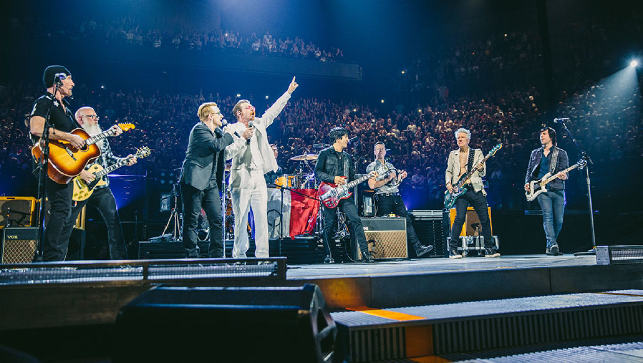 This handout picture taken on December 7 by Danny North and released by LIVENATION shows U2 frontman Bono (3rd L) and Jesse Hughes (4th L), the Eagles of Death Metal singer performing with their bands at the packed 16,000-seat AccorHotels Arena in Paris. Eagles of Death Metal, the US rock band who survived a jihadist attack on their concert in Paris last month, made an emotional return to the stage in the French capital on the night of December 7 alongside U2.