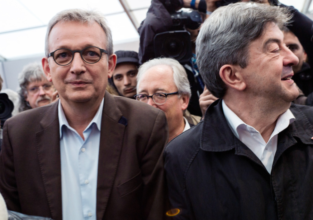 "FRANCE, La Courneuve : French Communist Party (PCF) national secretary Pierre Laurent (L) stand next to co-president of the Left Front ( Front de Gauche ) party Jean Luc Melenchon (R) during the ""Fete de l'Humanite"", a political event and music festival organized by the French Communisy party (PCF) on September 13, 2013 in La Courneuve, outside Paris. AFP PHOTO / FRED DUFOUR"