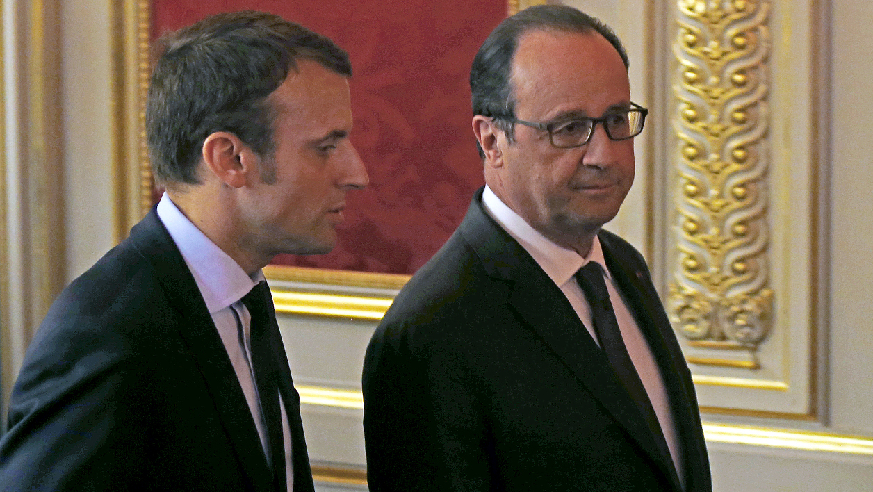 "French President Francois Hollande (R) listens to French Economy Minister Emmanuel Macron (L) during a meeting entitled ""Nouvelle France Industrielle"", at the Elysee Palace, in Paris, on May 23, 2016.  Francois Mori / POOL / AFP"