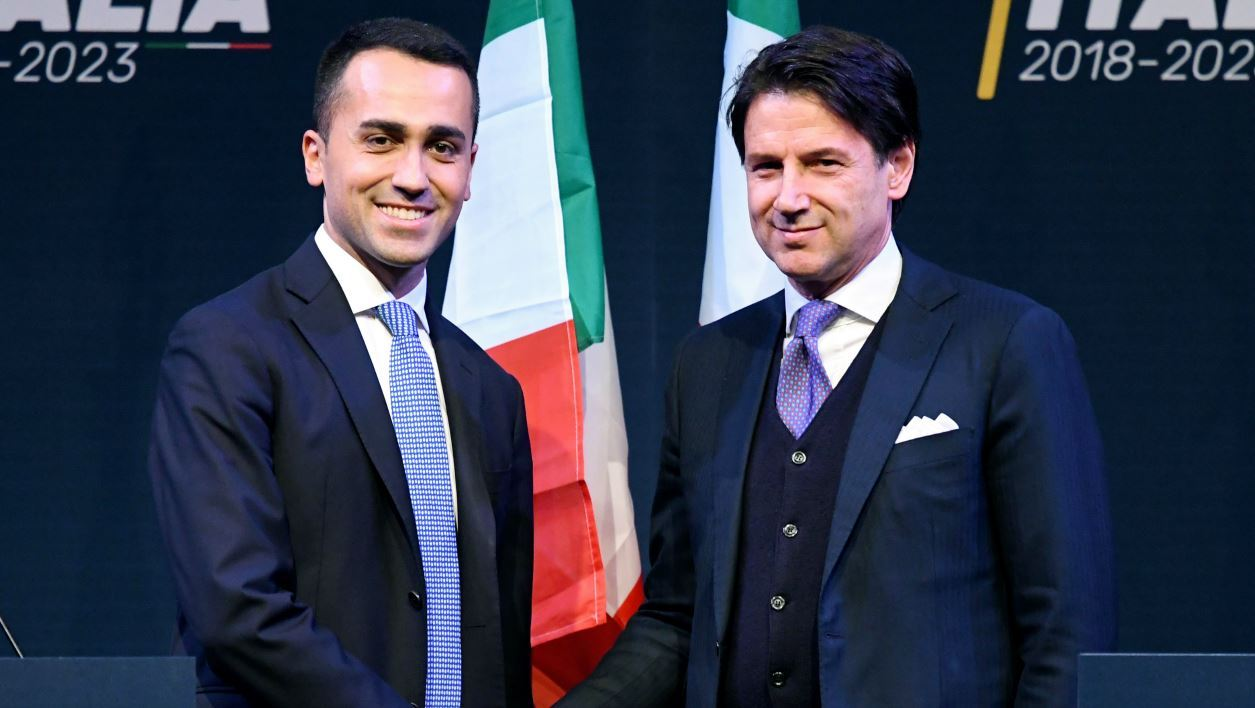 In this file photo taken on March 01, 2018 Leader of the Italy's populist Five Star Movement, Luigi Di Maio (L), shakes hands with Italian lawyer Giuseppe Conte, as Di Maio presents his would-be cabinet team.