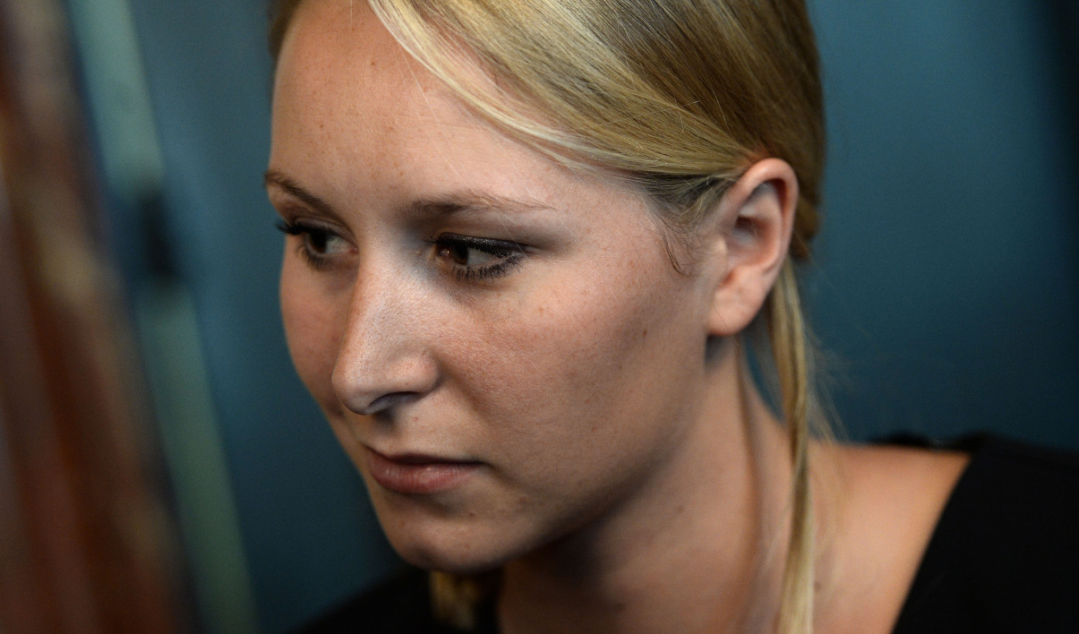 "French far-right Front National (FN) party deputy and member of the ""Movement for a Europe of Liberties and Democracy"" (MELD) Marion Marechal-Le Pen takes part in a press conference to mark the tenth anniversary of the ""No"" to the European Constitution referenda on May 29, 2015 in Paris"