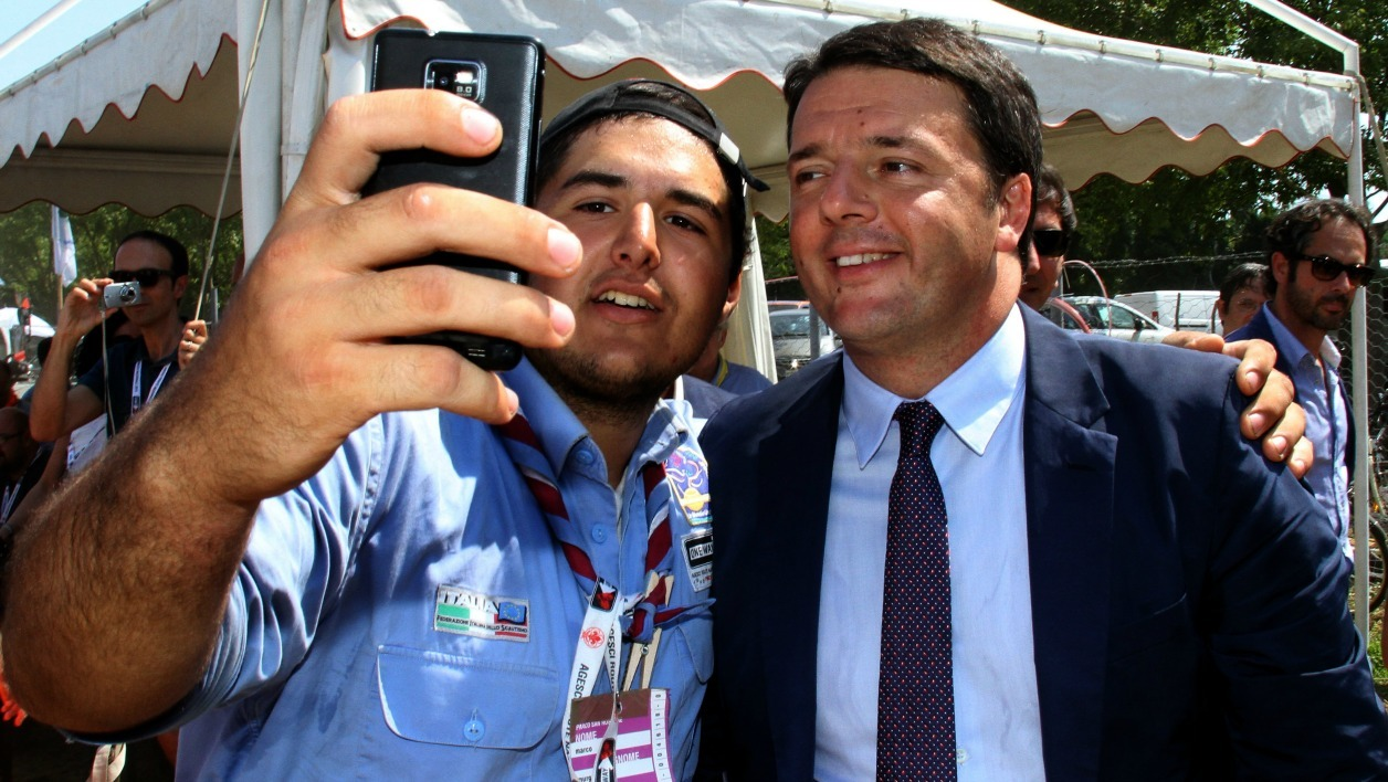 "Italy's Prime minister Matteo Renzi (R) makes a selfie with a scout during the scout meeting ""Route 2014"" in San Rossore near Pisa on August 10 , 2014. AFP PHOTO / STR"