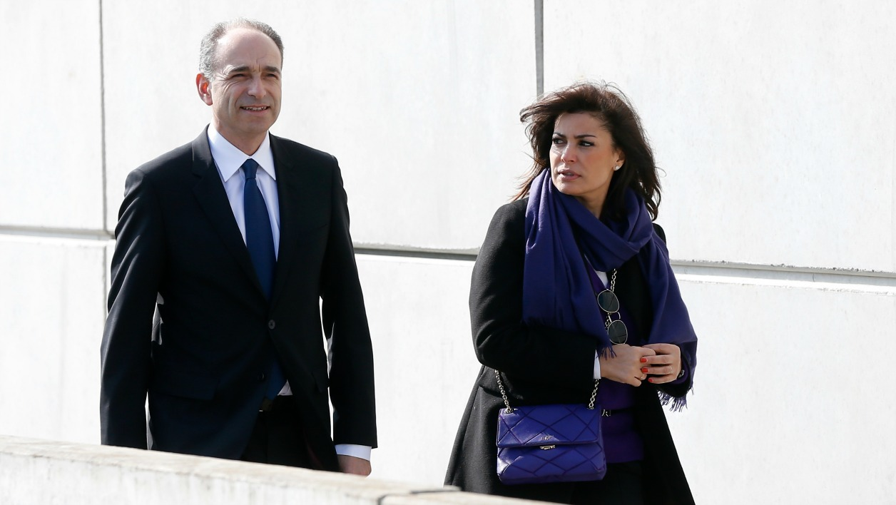 French right-wing party Les Republicains (LR) party member, Jean-Francois Cope (L) and his wife Nadia arrive for a rally in Meaux, of which he is mayor of, launching his campaign as LR candidate for the primary elections ahead of the 2017 presidential elections.  THOMAS SAMSON / AFP