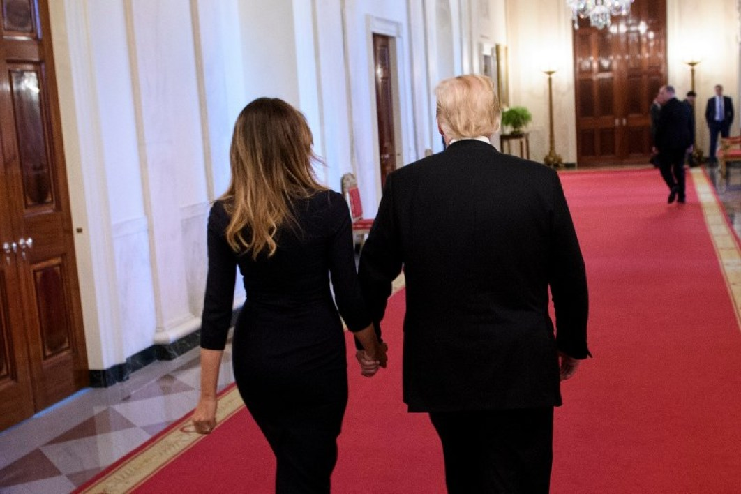 US First Lady Melania Trump and US President Donald Trump leave an event on a year of progress and action to combat the opioid crisis, in the East Room of the White House on October 24, 2018 in Washington, DC.  Brendan Smialowski / AFP