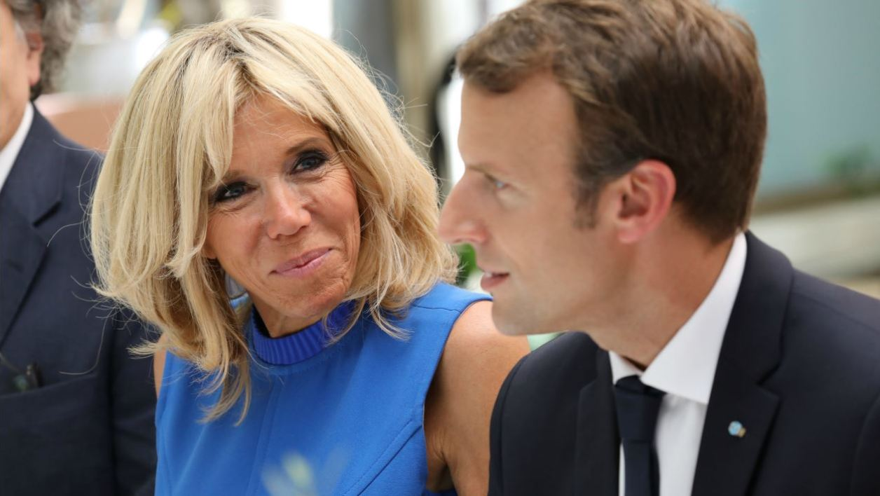 French President Emmanuel Macron (R) and his wife Brigitte Macron look on during a reception on September 8, 2017 in Athens, as part of a two-day official visit of the French president to Greece.  LUDOVIC MARIN / AFP