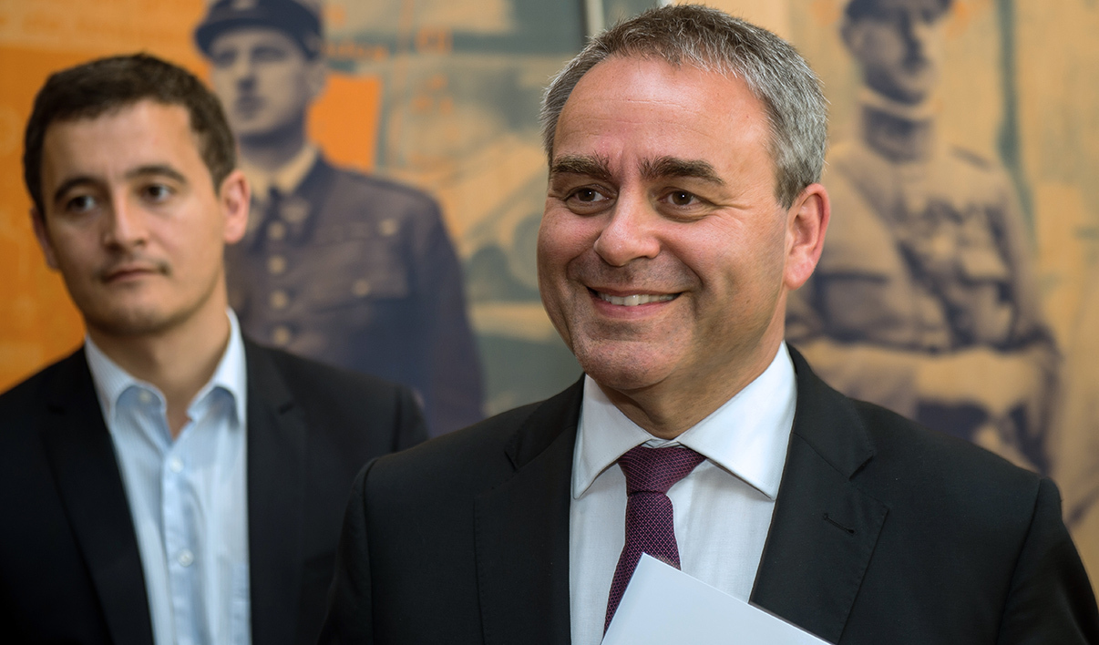 "Former French labor minister and main opposition right-wing ""Les Republicains"" candidate for the regional elections in the Nord-pas-de-Calais -Picardie Xavier Bertrand visits the home of French General Charles de Gaulle in Lille on June 18, 2015, accompanied by Mayor of Tourcoing Gerald Darmanin"
