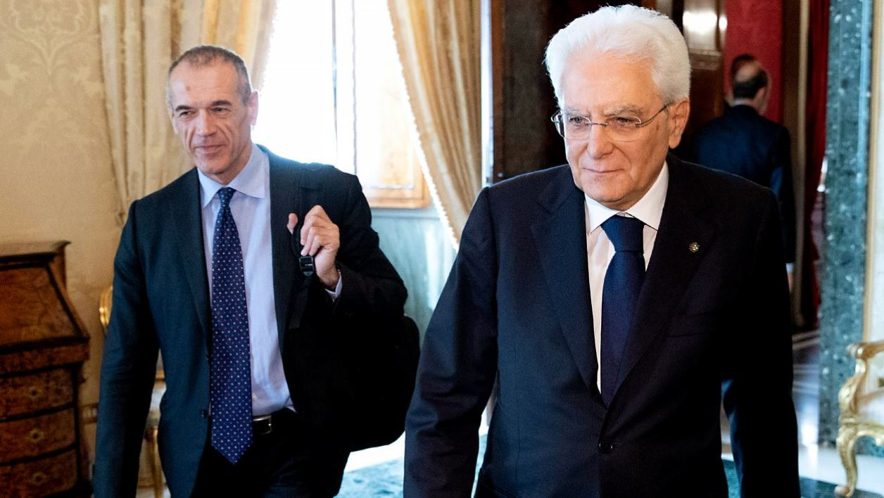 This handout photo taken and delivered by the Italian Presidency press office (Ufficio Stampa Presidenza Della Repubblica) on May 29, 2018 shows Italian President Sergio Mattarella (L) welcoming designated Prime Minister Carlo Cottarelli (R) at the Quirinale Palace in Rome on May 29, 2018.