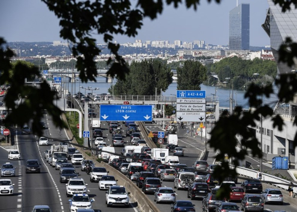"Motorists drive in heavy traffic along the A7 motorway south of Lyon, on August 3, 2018, on the first major weekend of the French summer holidays. This weekend is expected to be ""most difficult of the summer"" for traffic, with hundreds of kilometers of traffic jams, as holiday-makers start or end their holidays. The A7, also known as the ""Autoroute du soleil"" (the Sun's motorway), links Paris to the French Mediterranean coast.  PHILIPPE DESMAZES / AFP"