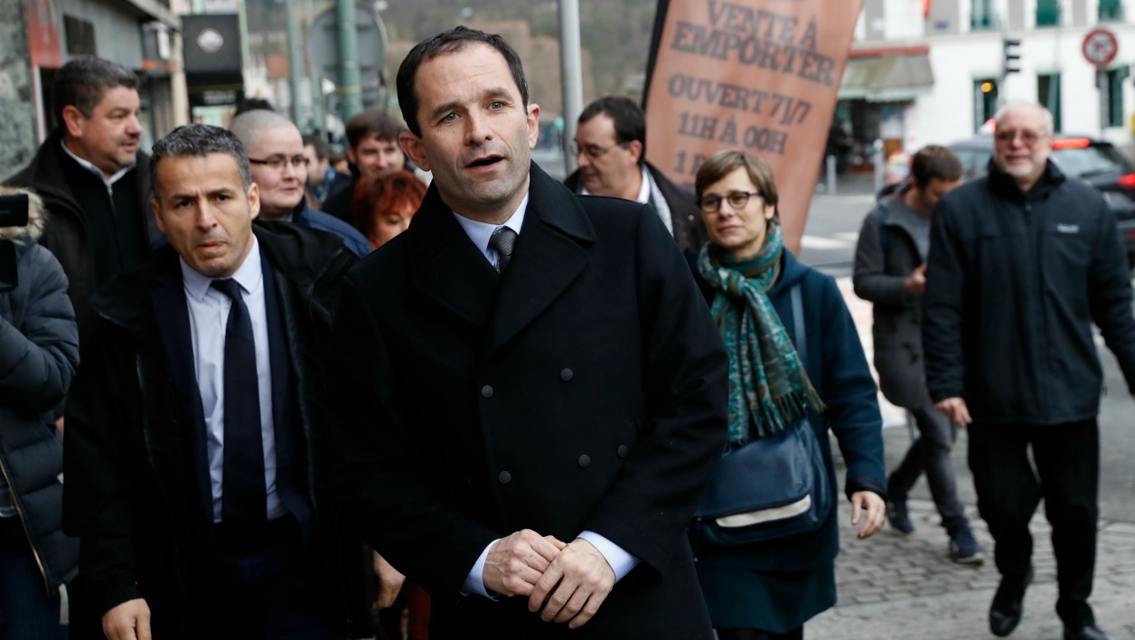 French presidential election candidate for the left-wing French Socialist (PS) party Benoit Hamon walks in a street as he visits Arcueil, outside Paris, on February 6, 2017.  Patrick KOVARIK / AFP