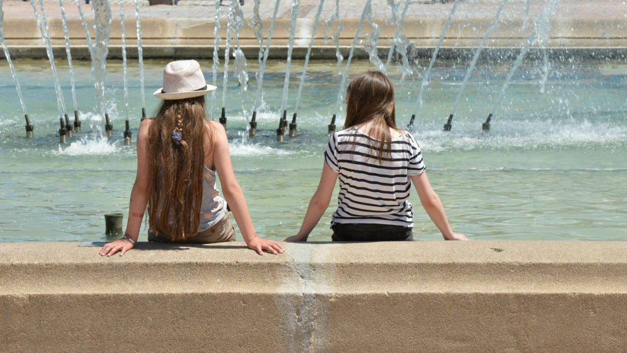 Teenagers freshen up in a public fountain, on June 30, 2015 in Limoges, as a major heatwave spreads up through Europe, with temperatures hitting nearly 40 degrees. AFP PHOTO PASCAL LACHENAUD  PASCAL LACHENAUD / AFP