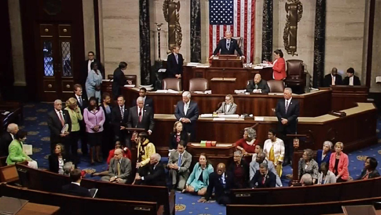 "This video grab courtsy of C-SPAN shows a sit-in at the US House of Representatives on June 22, 2016 in Washington, DC. US Democrats staged a rare sit-in Wednesday in the House of Representatives, demanding that the Republican-led body vote on gun-control legislation following the Orlando nightclub massacre.""We have to occupy the floor of the House until there is action,"" Democratic Congressman John Lewis, a civil rights icon who marched with Reverend Martin Luther King Jr in the 1960s, said before he and dozens of colleagues sat down on the carpeted well of the chamber.The dramatic action came just as the House presiding officer moved to declare the body in recess.  Handout / C-SPAN / AFP"