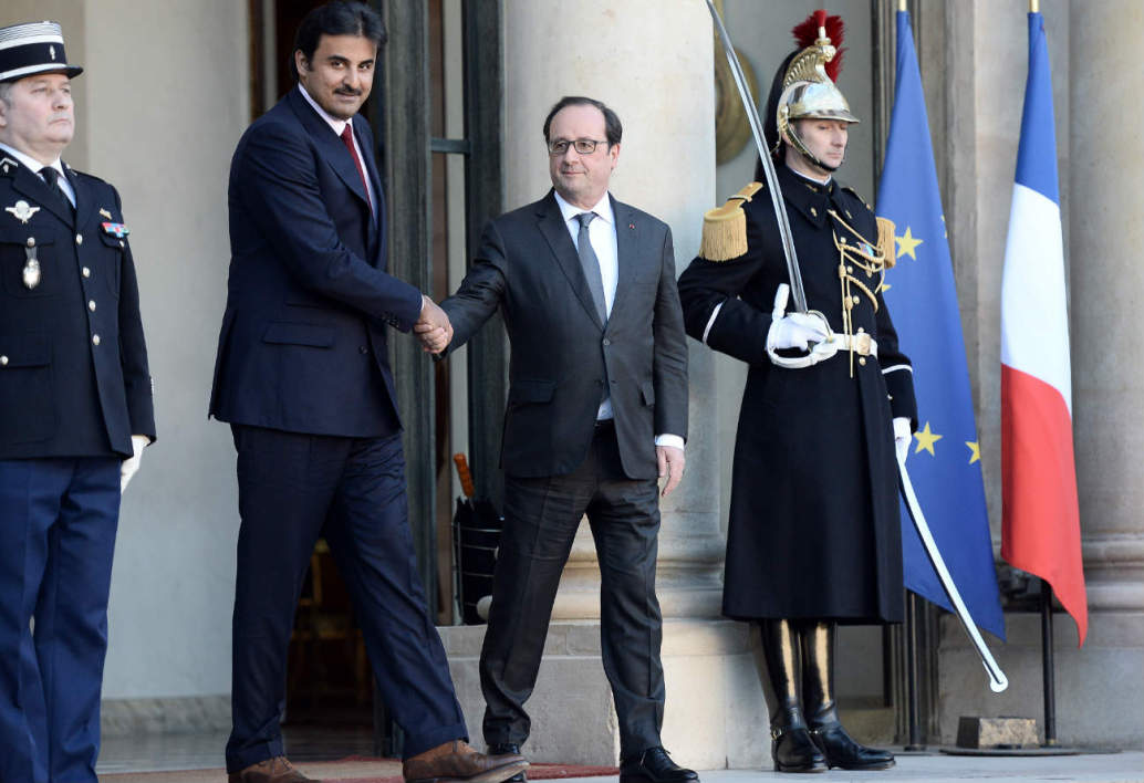 France's President Francois Hollande (R) escorts Emir of Qatar Sheikh Tamim bin Hamad al-Thani following their meeting on February 16, 2016 at the Elysee Presidential Palace in Paris.