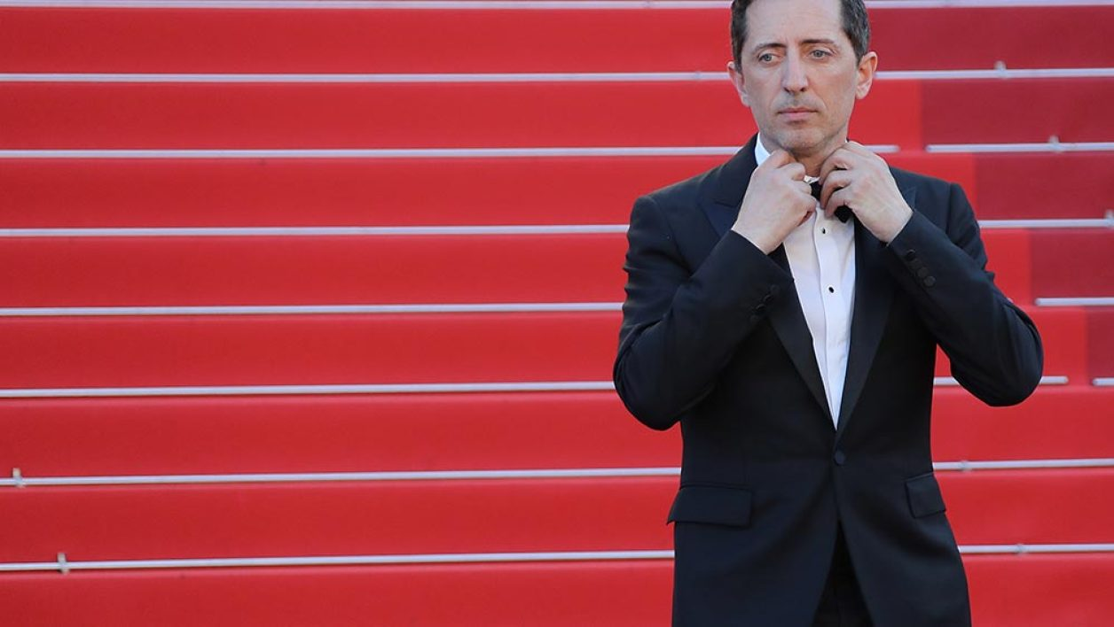 "French-Moroccan stand-up comedian Gad Elmaleh poses as he arrives on May 21, 2016 for the screening of the film ""Elle"" at the 69th Cannes Film Festival in Cannes, southern France."