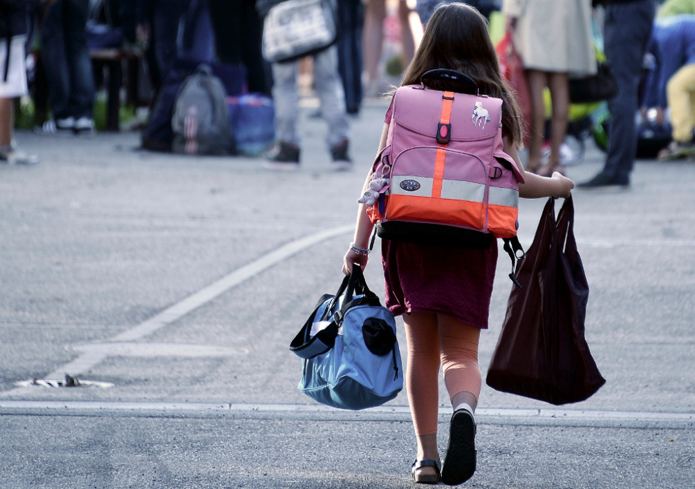 FRANCE, Strasbourg : A pupil walks in the courtyrard of a school, on September 2, 2014 in Strasbourg, eastern France at the start of the new school year. AFP PHOTO/FREDERICK FLORIN