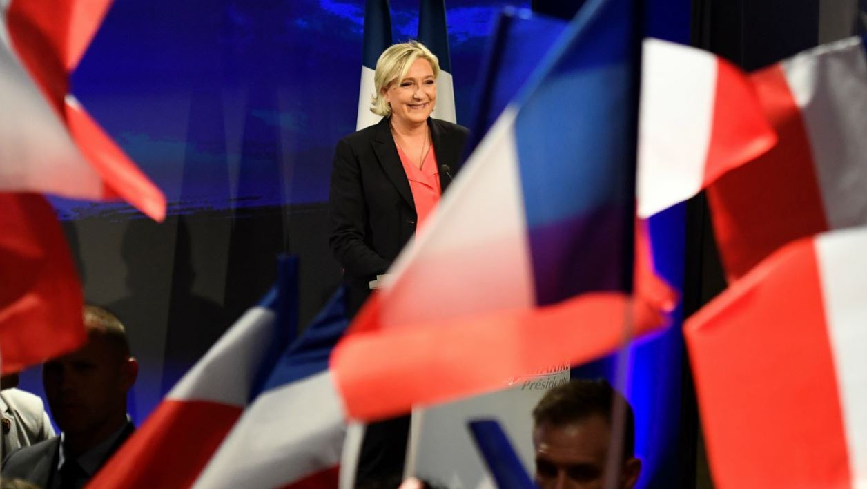 French presidential election candidate for the far-right Front National (FN) party Marine Le Pen delivers a speech in Paris, on May 7, 2017, after the second round of the French presidential election. Marine Le Pen suffered a crushing defeat in France's presidential election, estimates showed today. bertrand GUAY / AFP