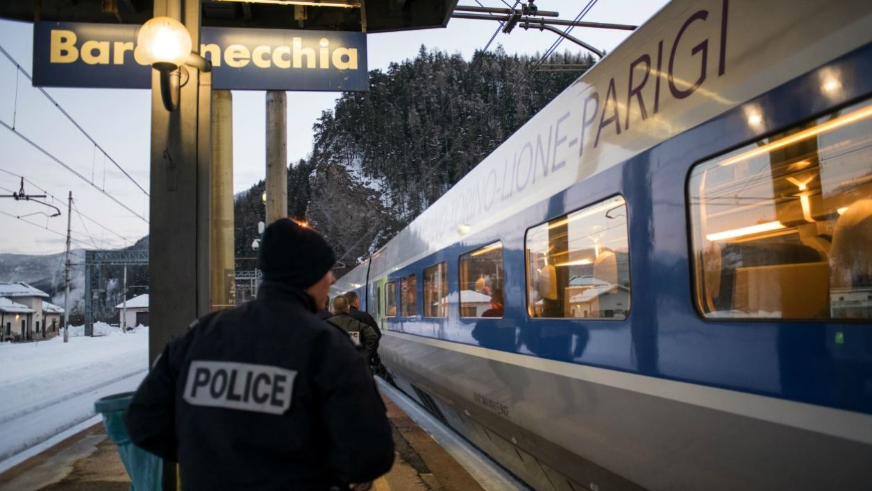 FILES) In this file photo taken on January 12, 2018 French police officers board a TGV train coming from Milan and direct to Paris to control passengers at the Bardonecchia train station. Italy denounced on March 31, 2018 French border agents for allegedly entering the Italian train station facility of Bardonecchia to force a Nigerian migrant to give a urine sample for a drug test.