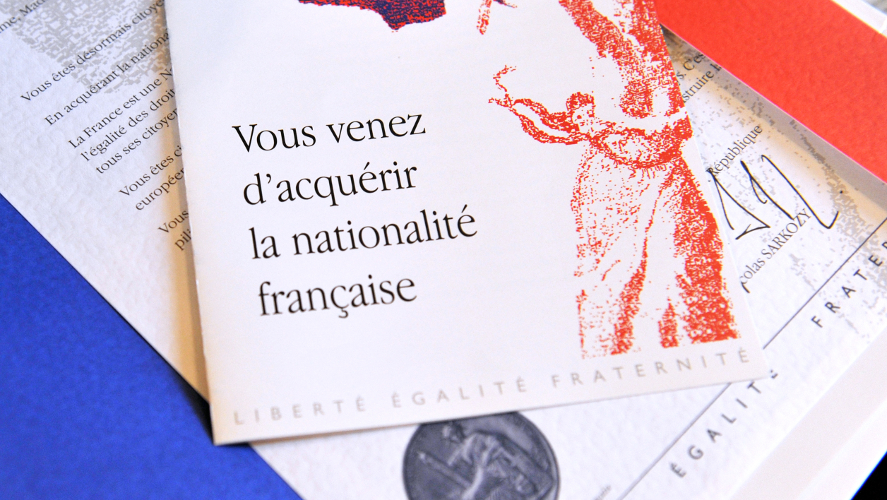 "Picture taken on March 21, 2012 in Tours shows a document given to newly naturalized French citizens bearing headline which translate as ""You just obtained the French nationality"" during an official ceremony to give their papers to foreigners who claimed French nationality in the prefecture of the central French city of Tours."