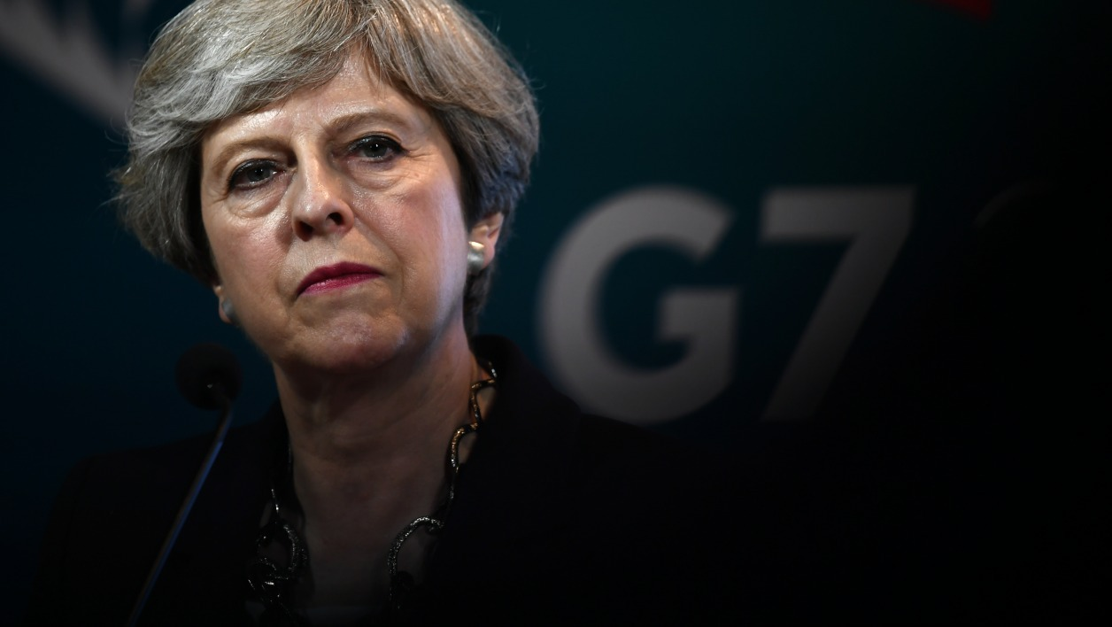 Britain's Prime Minister Theresa May gives a press conference during the Summit of the Heads of State and of Government of the G7, the group of most industrialized economies, plus the European Union, on May 26, 2017 in Taormina, Sicily.