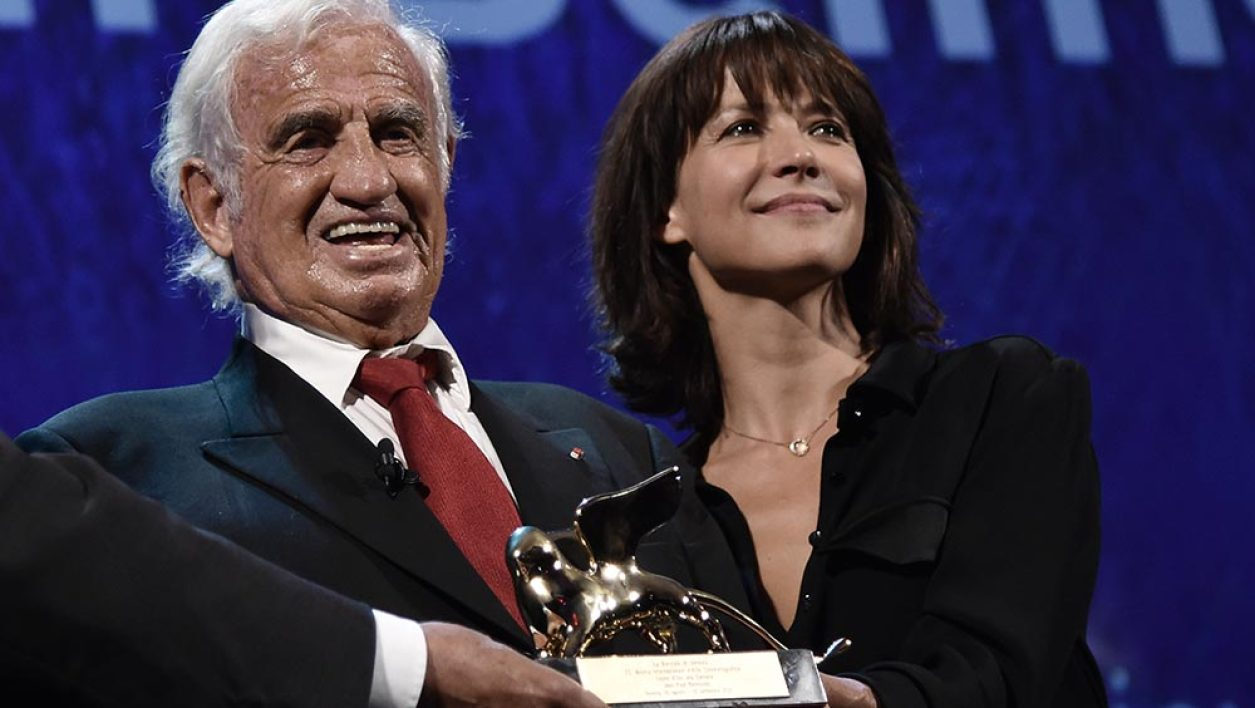 French actor Jean-Paul Belmondo poses with French actress Sophie Marceau after he received the Golden Lion for Lifetime Achievment award during the 73rd Venice Film Festival on September 8, 2016 at Venice Lido.