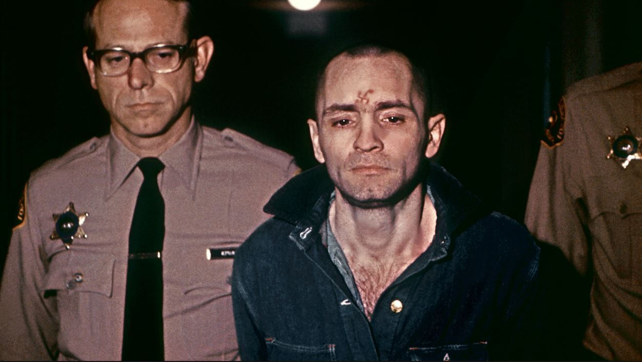 Beardless and shaven-headed, Charles Manson, is sullen faced as he goes to hear sentence of death in the gas chamber passed by the court 29 March 1971 in Los Angeles.
