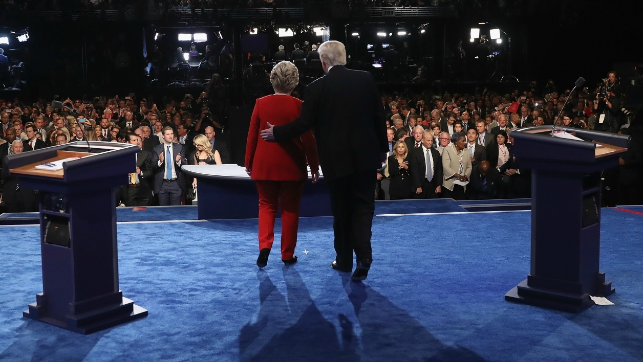 Democratic nominee Hillary Clinton (L) and Republican nominee Donald Trump greet the audience at the end of the first presidential debate at Hofstra University in Hempstead, New York on September 26, 2016. Hillary Clinton and Donald Trump face off in one of the most consequential presidential debates in modern US history with up to 100 million viewers set to tune in. joe raedle / POOL / AFP