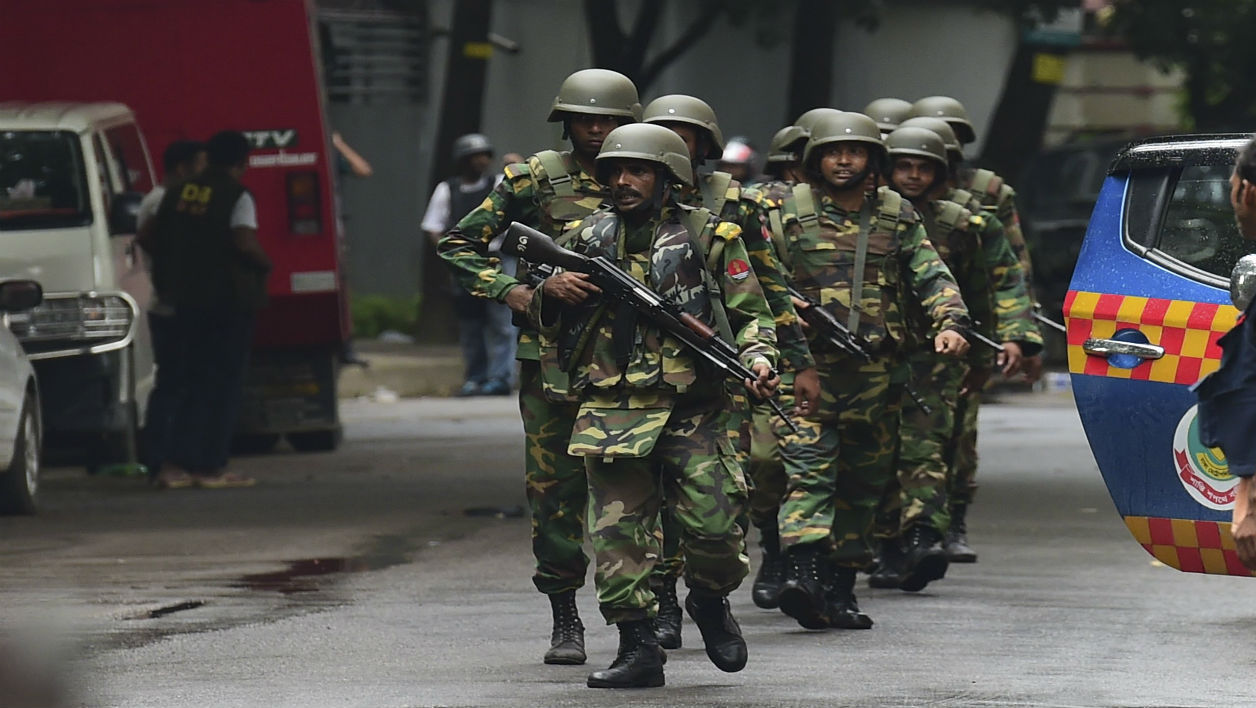 Bangladeshi army soldiers patrol a street during a rescue operation as gunmen take position in a restaurant in the Dhaka's high-security diplomatic district on July 2, 2016 where several people including foreigners are believed to be trapped.