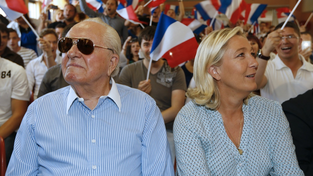 French far-right leader Marine Le Pen (R) and her father France's former far-right leader Jean-Marie Le Pen attend a youth summer congress of the Front National (FN) far-right party , on september 7, 2014, in Frejus, southern France. AFP PHOTO / VALERY HACHE  VALERY HACHE / AFP