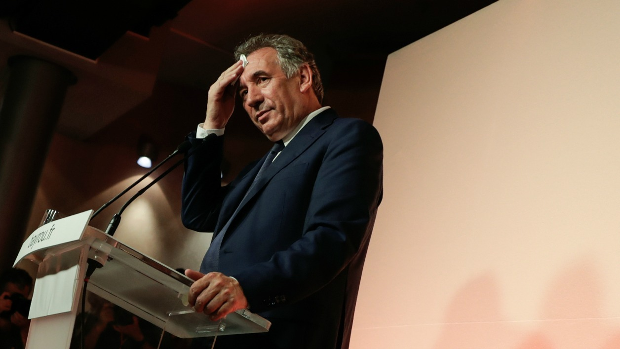 Outgoing French Minister of Justice and Leader of the French MoDem centrist party Francois Bayrou wipes his face as he addresses media representatives during a press conference at the MoDem party headquarters in Paris, on June 21, 2017.
